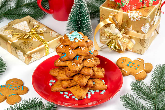 Gingerbread with gifts and christmas tree branches