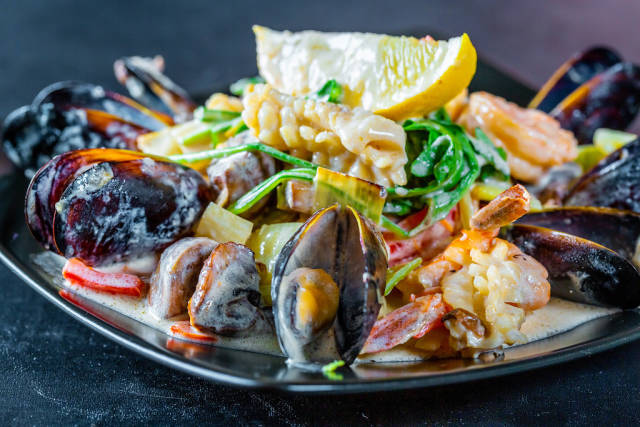 Seafood with grilled vegetables in cream sauce