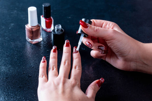 Womens red manicure