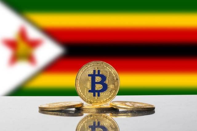Golden Bitcoin and flag of Zimbabwe