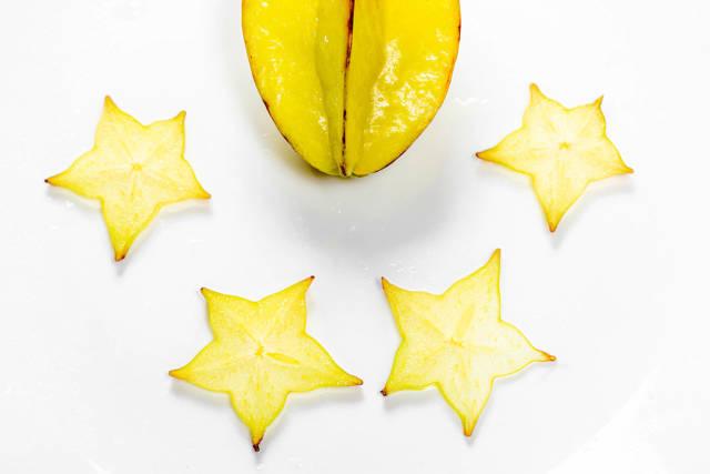 Ripe star fruit carambola or star apple on white background