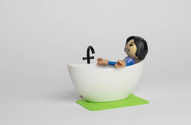 Woman lying in bathtub and taking bath