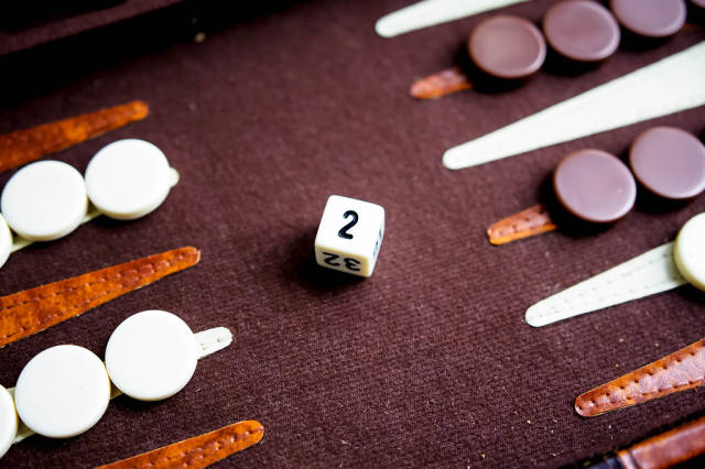 Backgammon doubling cube on game board