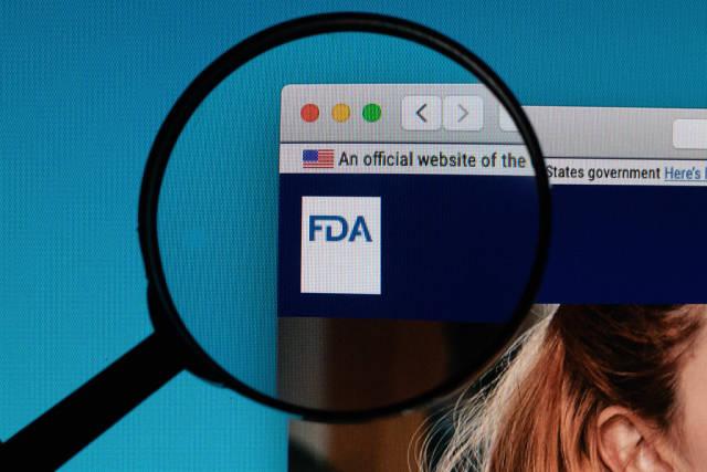 U.S. Food and Drug Administration logo under magnifying glass