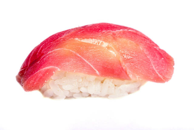Nigiri with tuna on a white background