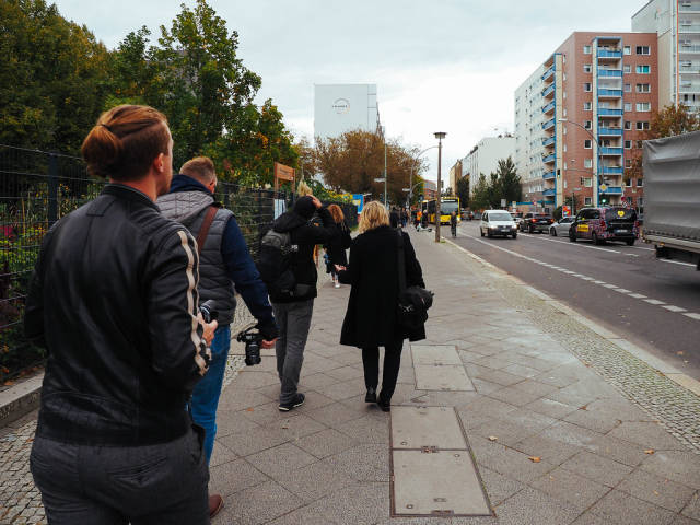 Tourists and photographers walking with cameras on the streets of Berlin