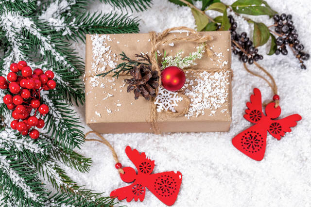 Festive background with a gift. The concept of surprise, make loved ones pleasant