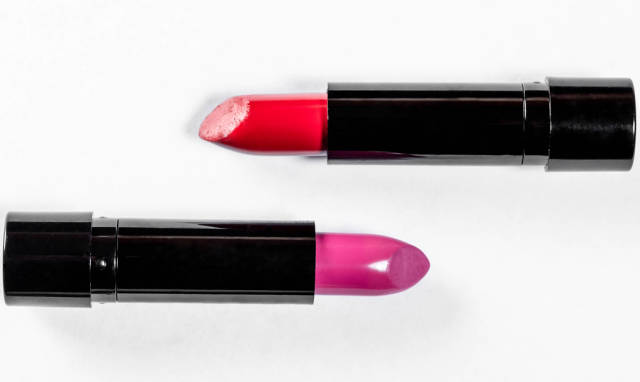 Two lipsticks on a white background. The concept of womens makeup