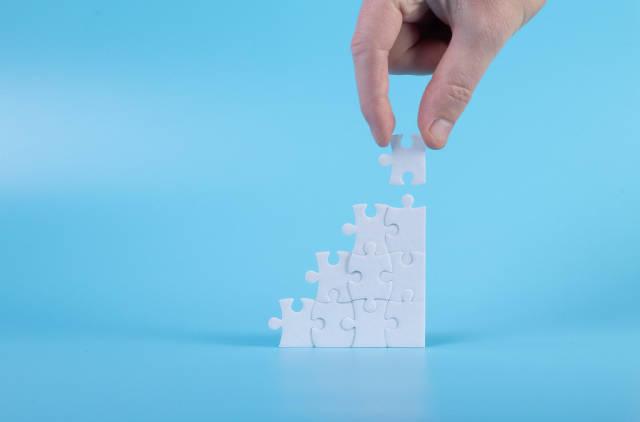 Man assembling a jigsaw puzzle