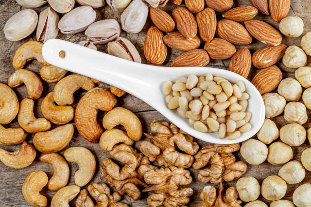Healthy snack concept-nuts on a wooden background, top view