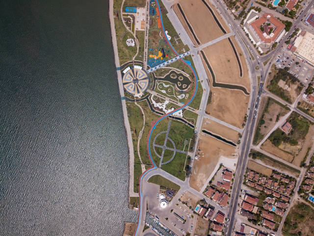 Birds eye view of a park with playground and sports courts in Fethiye, Turkey
