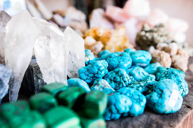 Precious stones on wooden table