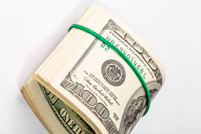 Dollars with elastic band for money on white background
