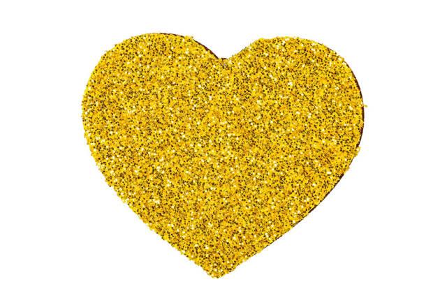 Shiny golden heart on white background
