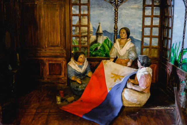 Model of women sewing the Philippine flag
