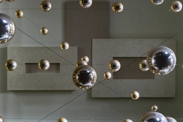 Low Angle View of the Metal Shiny Balls Hanging from The Ceiling
