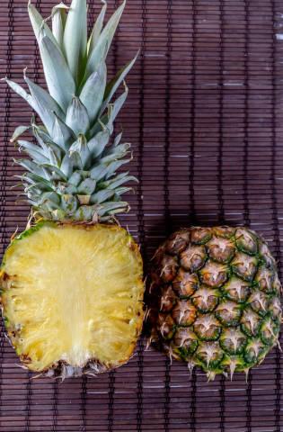 Halves of ripe fresh pineapple