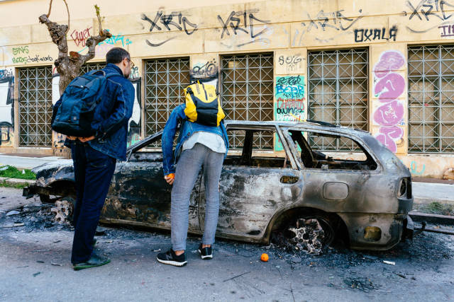 Burned down car in Athens