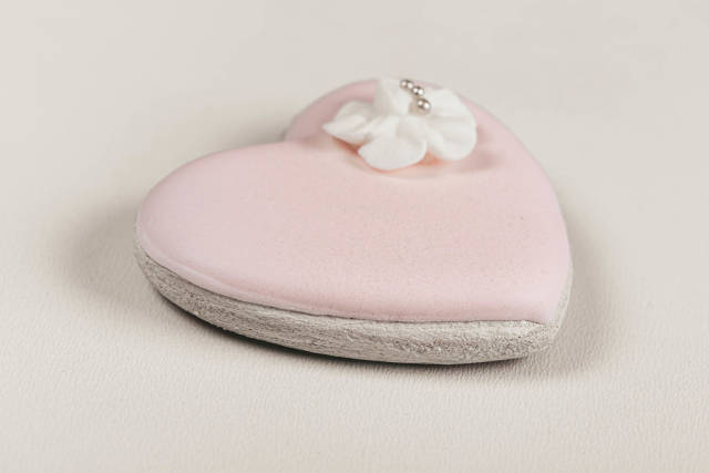 Heart shaped gingerbread with pink icing
