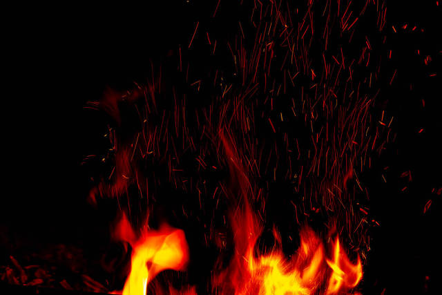 Fire and sparks on a dark night background