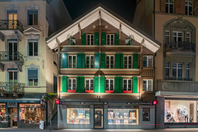 Small Swiss old house with wooden window shutters in Interlaken at night