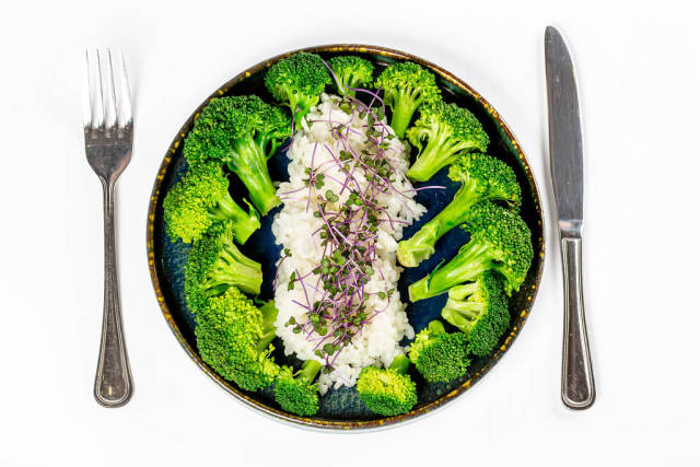 Top view, steamed rice with broccoli, healthy food concept