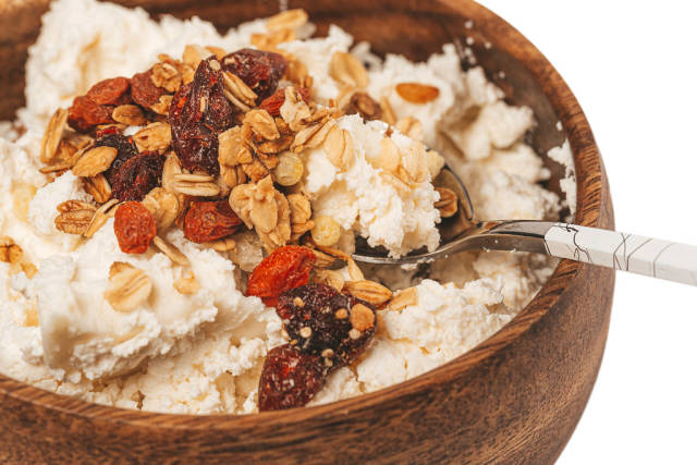 Close-up, cottage cheese with dried berries and oatmeal