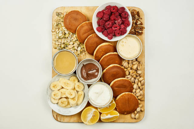 Beautifully served breakfast on wooden cutting board