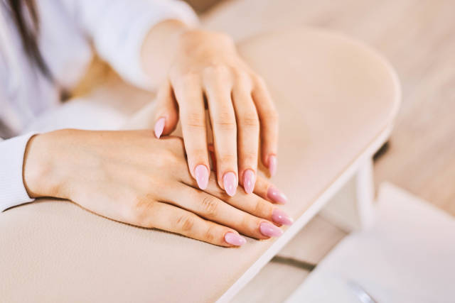 Beautiful female hands with manicured nails