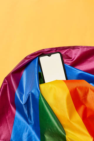 Rainbow flag and a smartphone with empty white screen