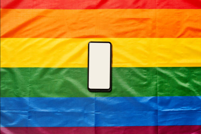 A smartphone with blank screen on rainbow lgbt flag