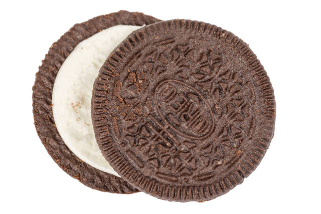 Chocolate cookie with milk cream inside, top view
