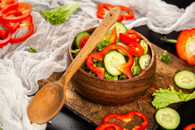 Salad with fresh cucumbers, tomato, lettuce and bell peppers