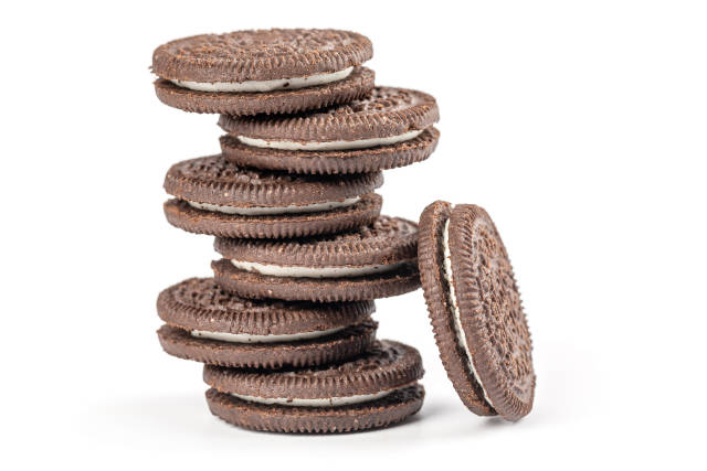 Stack of chocolate cream oreo cookies on white