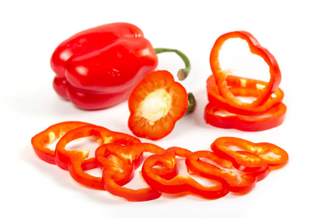 Whole and pieces of red bell pepper