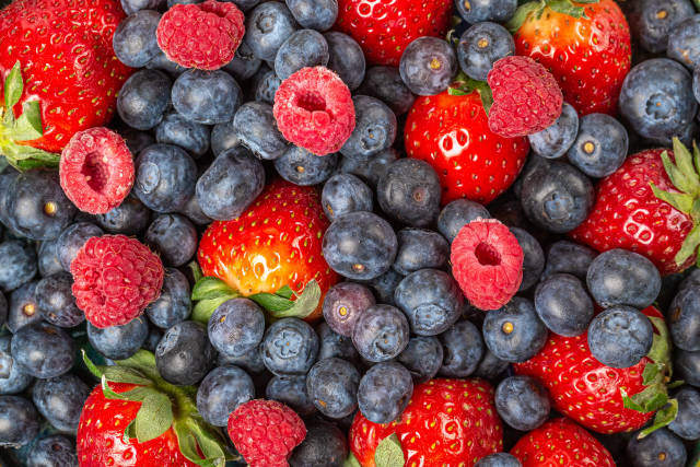 Berries strawberries, blueberries and raspberries background