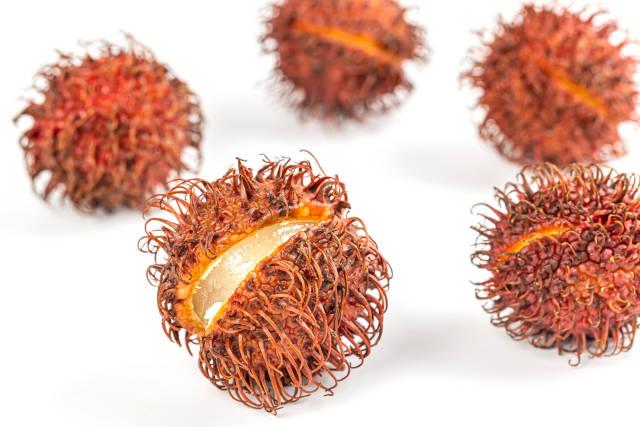 Fresh ripe rambutan fruits on white background