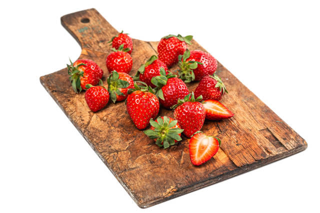 Red fresh strawberries on wooden old kitchen board