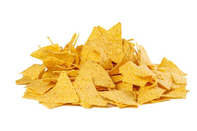 Yellow triangular chips on white background