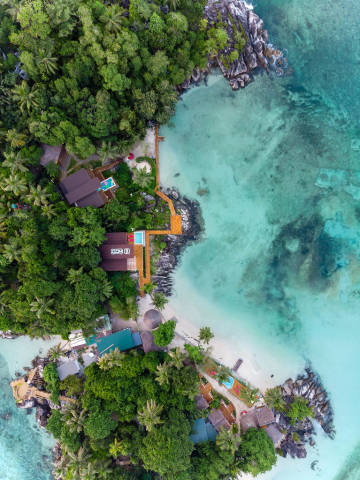 aerial view shows Dom-2 houses on the tropical LIslette Island of the Seychelles in the Indian Ocean that are used as film location for Russian Reality TV