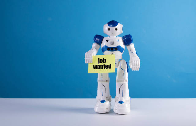 Robot holding a sing with Job wanted text