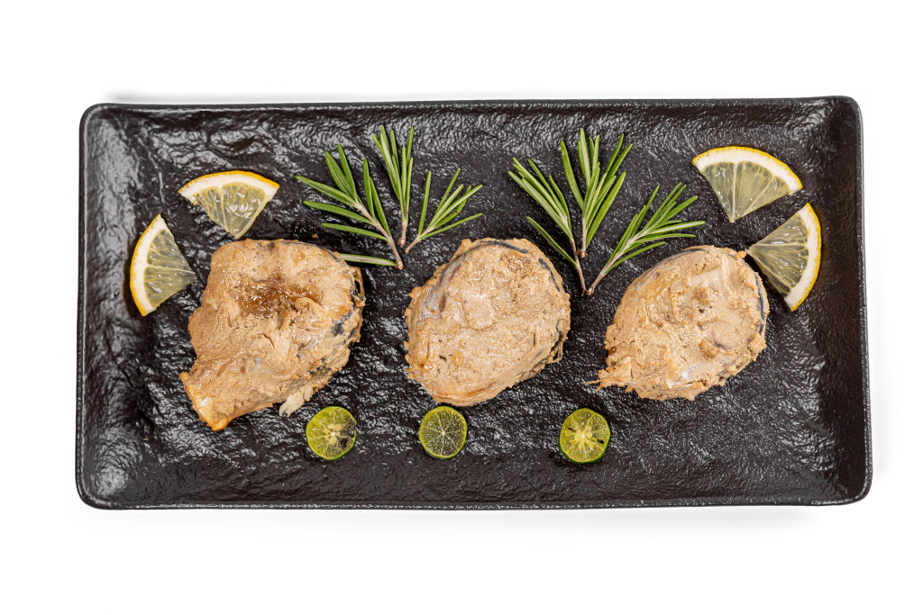 Top view, baked mackerel slices with rosemary and lemon