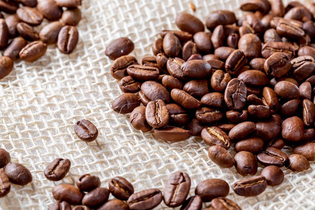 Roasted coffee beans on burlap