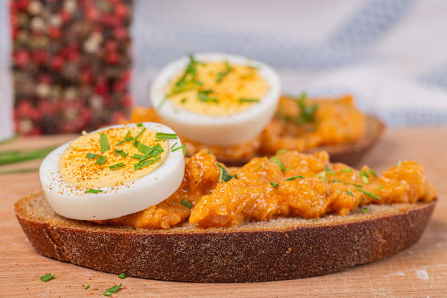 Rye bread with squash pate and egg, close up