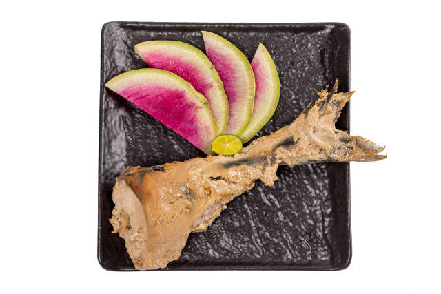 Baked fish tail with watermelon radish slices