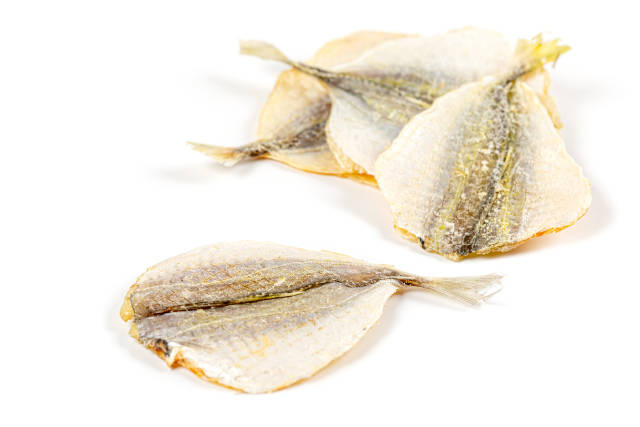 Dried horse mackerel fish on white background