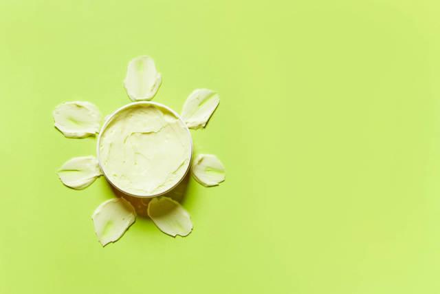 Opened container of sun cream