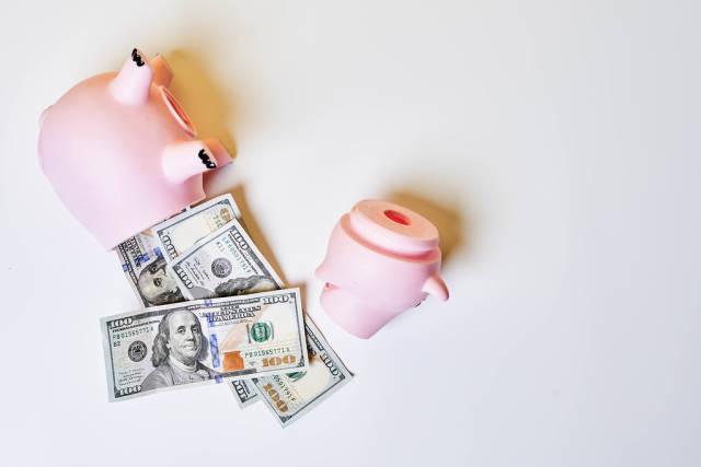Money in Broken Piggy Bank