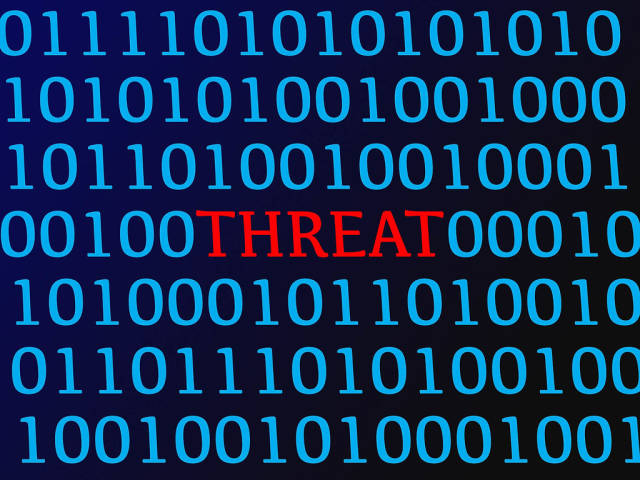 Threat red text between blue binary data on screen