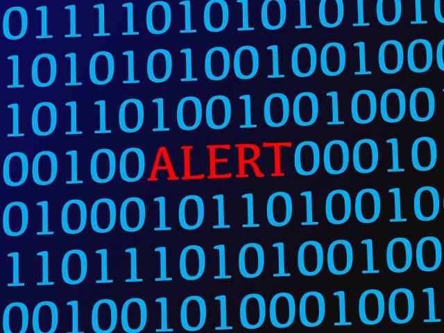 Alert red text between blue binary data on screen
